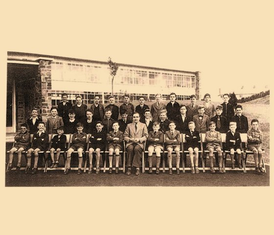 Mr Quinn with 5th standard 1954
