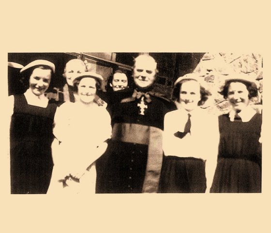 Bishop Farren surrounded by group of girls 1954