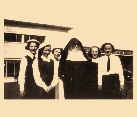 Sister Augustine and some senior girls at the opening 1954