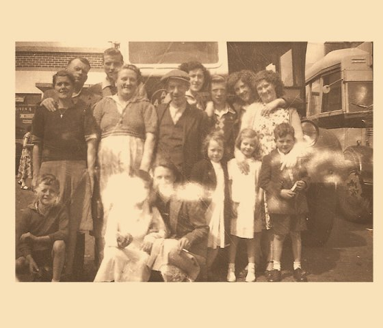 James (Jimmy) Jennings is standing behind the older woman on the left, the young man on the right at the back between the two girls is my father Charlie Curley, It is believed that this was a group going on a bus run.
