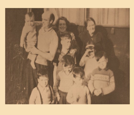 The Morrin Family with Mrs Mary Mc Geady  and all their children at the front of their Hut