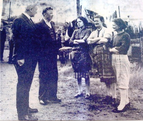Eddie Mc Ateer (nationalist MP) Chatting to the residents of Springtown Camp)